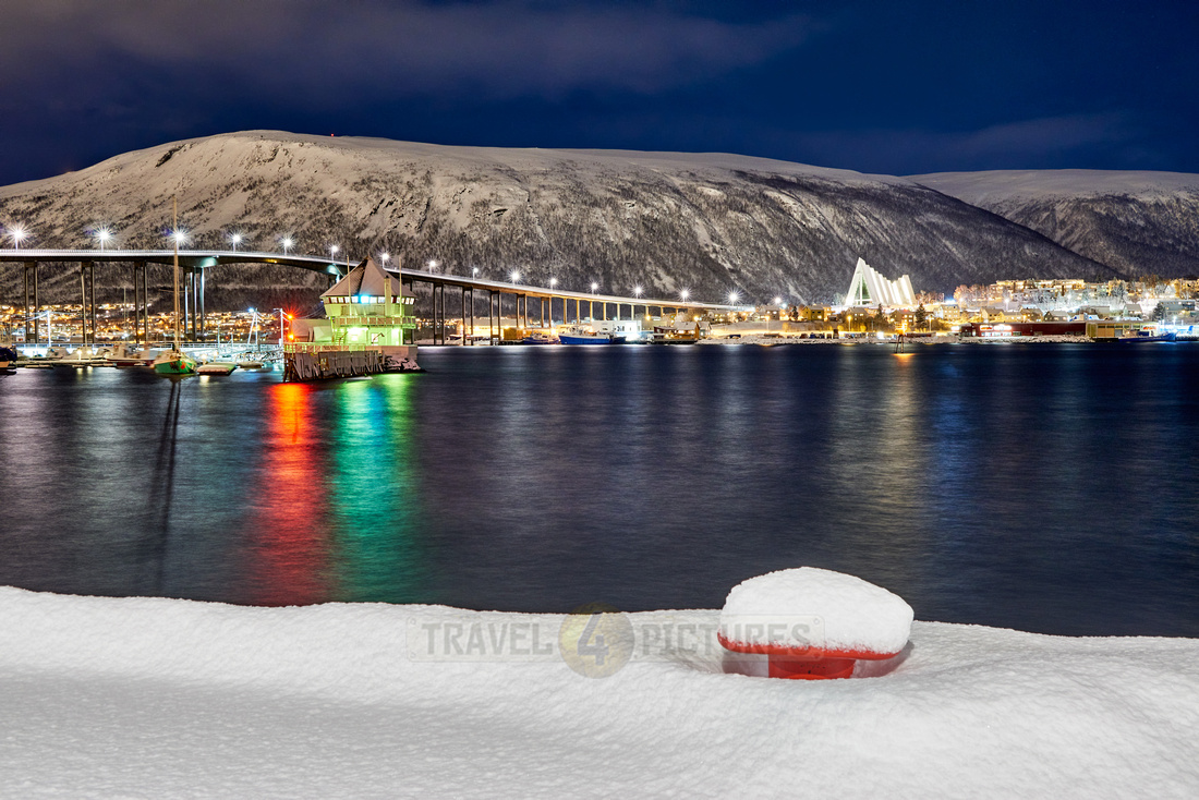 snow covered landscape of harbor in Tromso