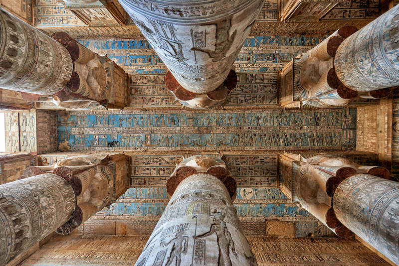 magnificent ceiling with colored stone carving in columns hall