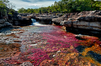 a waterfall at Cano Cristales