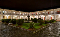 night shot of inner courtyard of Hotel Dann Monasterio