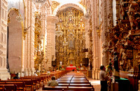 heavily decorated high altar made of gold leaf of the Church of San Sebastian y Santa Prisca