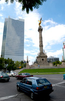 Independence Monument El Angel with surrounding office buildings