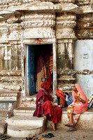Women dressed in colorful saris at a small Hindu temple