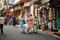 women in colorful saris in street of Udaipur