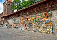 stalls with paintings at city wall