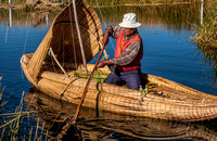 fisherman of local Uros tribe on reed boat
