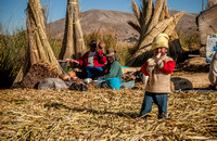 Indigenas and child of local Uros on Lake Titicaca