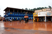 flooded road and coloured houses in Kabale
