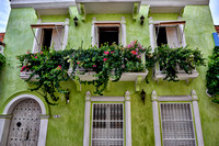 typical colorful facades with balconies and flowers