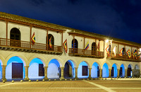 "night shot of flags of Cartagena at historical facade of town hall ""Alcaldia Mayor"""