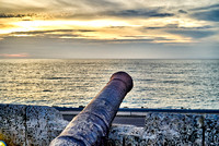 cannon and sunset at Cafe del Mar