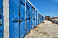 locked wooden blue doors in row from fishery equipment sheds