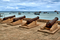 historical cannons in harbor of Stone Town