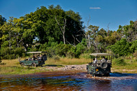 Safari cars crossing water